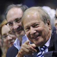 Photo - In this April 12, 2010 photo, New Jersey Nets owners Lewis Katz, right, and Bruce Ratner sit courtside at an NBA basketball game against the Charlotte Bobcats  in East Rutherford, N.J.   The editor of The Philadelphia Inquirer says co-owner Lewis Katz is among the seven people killed in a plane crash in Massachusetts.  Bill Marimow confirmed Katz's death to Philly.com on Sunday, June 1, 2014 saying he learned the news from close associates.  The plane crashed and caught fire as it was leaving Hanscom Field while on its way to Atlantic City International Airport. Massachusetts Port Authority spokesman Matthew Brelis says there were no survivors in the crash.  (AP Photo/Bill Kostroun)