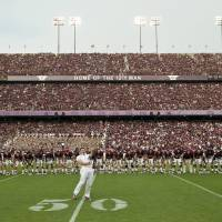 Photo -   FILE - In this Sept. 4, 2011, file photo,Texas A&M yell leader rallies in front of the team during the school song before an NCAA college football game against SMU, in College Station, Texas. The Southeastern Conference cleared the way for Texas A&M to join its ranks in an announcement Wednesday, Sept. 7, 2011, but with one snag. A Big 12 school has threatened to sue if the Aggies leave the fold.(AP Photo/Dave Einsel, File)