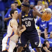 Photo - Zach Randolph (50) of Memphis looks over Nick Collison (4) of Oklahoma City in the first half during game one of the Western Conference semifinals between the Memphis Grizzlies and the Oklahoma City Thunder in the NBA basketball playoffs at Oklahoma City Arena in Oklahoma City, Sunday, May 1, 2011. Photo by Nate Billings, The Oklahoman ORG XMIT: KOD