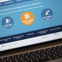 Photo - The HealthCare.gov website is shown on a laptop in Washington, Monday, March 31, 2014. Today is the deadline to sign up for private heath insurance in the online markets created by President Obama's heath care law or face a federal fines. (AP Photo/J. David Ake)