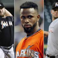 Photo -   This photo combo made from file photos shows Miami Marlins players, from left, pitcher Mark Buehrle, shortstop Jose Reyes, and pitcher Josh Johnson. Miami traded the three players to the Toronto Blue Jays, a person familiar with the agreement said Tuesday, Nov. 13, 2012. The person confirmed the trade to The Associated Press on condition of anonymity because the teams weren't officially commenting. The person said the trade sent several of the Blue Jays' best young players to Miami. (AP Photos)