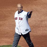 Photo -   Former Boston Red Sox manager Terry Francona walks onto the field during ceremonies to celebrate the 100th anniversary of the first regular season baseball game at Fenway Park, before a game between the New York Yankees and the Red Sox in Boston, Friday, April 20, 2012. (AP Photo/Michael Dwyer)