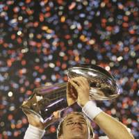 Photo -   FILE - In thie Feb. 7, 2010 file photo New Orleans Saints quarterback Drew Brees (9) holds the Vince Lombardi Trophy after the NFL Super Bowl XLIV football game against the Indianapolis Colts in Miami. The Saints won 31-17. After years of scorn from their fans, the Saints finally became Super Bowl champions. (AP Photo/David J. Phillip)