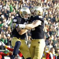 Photo -   Notre Dame wide receiver John Goodman, left, celebrates with tight end Troy Niklas after scoring a touchdown against Wake Forest during the first half of an NCAA college football game in South Bend, Ind., Saturday, Nov. 17, 2012. (AP Photo/Michael Conroy)