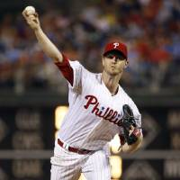 Photo - Philadelphia Phillies' Kyle Kendrick pitches during the fourth inning of a baseball game against the Washington Nationals, Wednesday, Aug. 27, 2014, in Philadelphia. (AP Photo/Matt Slocum)