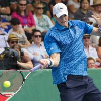 Photo - John Isner of the U.S. returns a shot to Taiwan's Lu Yen-hsun in their men's singles final match at the Heineken Open tennis tournament in Auckland, New Zealand, Saturday, Jan. 11, 2014. (AP Photo/SNPA, David Rowland) NEW ZEALAND OUT