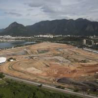 Photo - FILE- In this April 11, 2013 file photo, the Olympic Park, that will host competitions for 10 sports at Rio's Olympics in 2016, is under construction in the area previously occupied by the Jacarepagua Autodrome in Rio de Janeiro, Brazil. Rio de Janeiro's mayor Eduardo Paes says he expects federations to continue complaining about the city's preparations until the start of the games, but that he will not bow to their pressure and will keep his focus on securing a legacy for Rio well beyond Olympics. (AP Photo/Felipe Dana, File)