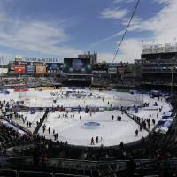 Photo - Fans wait for the start of an outdoor NHL hockey game between the New Jersey Devils and the New York Rangers Sunday, Jan. 26, 2014, at Yankee Stadium in New York. (AP Photo/Frank Franklin II)