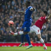 Photo - Arsenal's Mikel Arteta, fights for the ball with Everton's Romelu Lukaku, during their FA Cup quarterfinal soccer match, at Emirates Stadium, in London, Saturday, March 8, 2014. (AP Photo/Bogdan Maran)