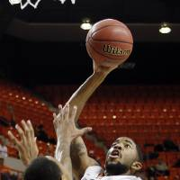 Photo - Oklahoma State's Michael Cobbins (20) shoots over TCU's Garlon Green (33) during their NCAA college basketball game, Wednesday, Jan. 9, 2013, in Stillwater, Okla. (AP Photo/The Oklahoman, Chris Landsberger) LOCAL TV OUT (KFOR, KOCO, KWTV, KOKH, KAUT OUT); LOCAL INTERNET OUT; LOCAL PRINT OUT (EDMOND SUN OUT, OKLAHOMA GAZETTE OUT) TABLOIDS OUT