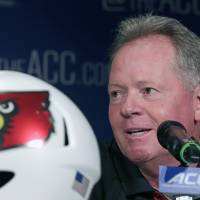 Photo - Louisville head coach Bobby Petrino answers a question during a news conference at the Atlantic Coast Conference Football kickoff in Greensboro, N.C., Monday, July 21, 2014. (AP Photo/Chuck Burton)