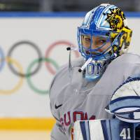 Photo - Goalkeeper of Finland's women's ice hockey team Noora Raty catches a puck during a practice session ahead of the 2014 Winter Olympics, Thursday, Feb. 6, 2014, in Sochi, Russia. (AP Photo/Petr David Josek)