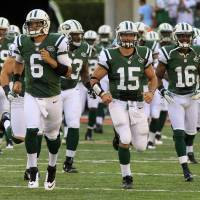 Photo -   FILE - In this Aug. 10, 2012, file photo, New York Jets quarterback Mark Sanchez (6) leads the team onto the field along with quarterback Tim Tebow (15) for an NFL preseason football game against the Cincinnati Bengals in Cincinnati. After a tumultuous offseason in which he was criticized by fans, media and anonymous New York Jets teammates, Sanchez has done everything he can to make his fourth NFL season special. (AP Photo/Al Behrman, File)
