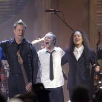 Photo - FILE - This April 4, 2009 file photo shows the band Metallica, from left,  Robert Trujillo, James Hetfield, Lars Ulrich, Kirk Hammett and Jason Newsted, after being inducted into the Rock and Roll Hall of Fame at the 2009 Rock and Roll Hall of Fame Induction Ceremony in Cleveland. (AP Photo/Tony Dejak, file)