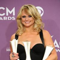 Photo - Miranda Lambert poses backstage with the awards for song of the year and single record of the year for