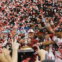 Photo - Bob Stoops and the Sooners celebrate their 45-31 win over Alabama in the Sugar Bowl on Jan. 2. Stoops might eventually leave for the NFL, but not for the likes of Cleveland. Photo by Chris Landsberger, The Oklahoman