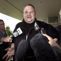 Photo - FILE - In this Feb. 22, 2012 file photo, Kim Dotcom, the founder of the file-sharing website Megaupload, comments after he was granted bail and released in Auckland, New Zealand. Indicted Megaupload founder Kim Dotcom has launched a new file-sharing website in a defiant move against the U.S. prosecutors who accuse him of facilitating massive online piracy. The colorful entrepreneur unveiled the