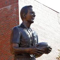Photo - Statues of 100 plus win head football coaches Benny Owen and Bud Wilkinson (shown) are unveiled before the college football game between the University of Oklahoma Sooners (OU) and the Texas Tech Red Raiders (TTU) across the street from the Gaylord Family Memorial Stadium on Saturday, Nov. 13, 2010, in Norman, Okla.  Photo by Steve Sisney, The Oklahoman