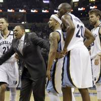 Photo - Memphis Grizzlies coach Lionel Hollins, second from left, restrains players Tayshaun Prince (21), Jerryd Bayless, Quincy Pondexter (20) and Marc Gasol, far right, after tempers flared during the first half of Game 6 in a first-round NBA basketball playoff series against the Los Angeles Clippers in Memphis, Tenn., Friday, May 3, 2013. The Grizzlies defeated the Clippers 118-105. (AP Photo/Danny Johnston)