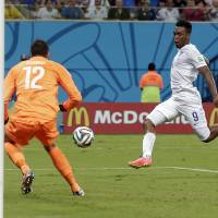 Photo - England's Daniel Sturridge (9) scores against Italy's goalkeeper Salvatore Sirigu (12) for England's first goal during the group D World Cup soccer match between England and Italy at the Arena da Amazonia in Manaus, Brazil, Saturday, June 14, 2014.  (AP Photo/Marcio Jose Sanchez)
