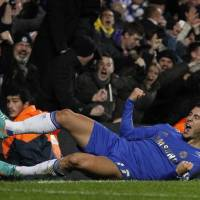 Photo -   Chelsea's Eden Hazard celebrates after scoring a goal, during the English League Cup soccer match between Chelsea and Manchester United at Stamford Bridge Stadium in London Wednesday, Oct. 31, 2012. (AP Photo/Sang Tan)