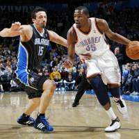 Photo - Oklahoma City's Kevin Durant (35) drives the ball past Hedo Turkoglu (15) of Orlando during the NBA basketball game between the Orlando Magic and Oklahoma City Thunder in Oklahoma City, Thursday, January 13, 2011. Photo by Nate Billings, The Oklahoman