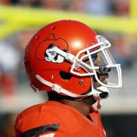 Photo - Oklahoma State's Jeremy Smith (31) warms up before a college football game between Oklahoma State University (OSU) and Iowa State University (ISU) at Boone Pickens Stadium in Stillwater, Okla., Saturday, Oct. 20, 2012. Photo by Sarah Phipps, The Oklahoman