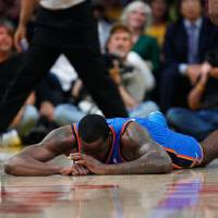 Photo -  Oklahoma City's Kendrick Perkins (5) lies on the court after being called for an offensive foul in the fourth quarter during Game 3 in the second round of the NBA basketball playoffs between the L.A. Lakers and the Oklahoma City Thunder at the Staples Center in Los Angeles, Saturday, May 19, 2012. Photo by Nate Billings, The Oklahoman