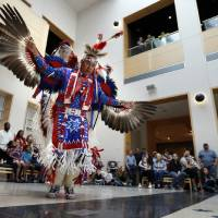 Photo -  Kevin Connywerdy does an eagle dance at this year's Spring Break Escape, sponsored by the Sam Noble Oklahoma Museum of Natural History.  PHOTO BY STEVE SISNEY, THE OKLAHOMAN   STEVE SISNEY -