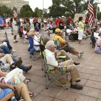 Photo - Oklahoma citizens listen to speakers during a healthcare rally on the south steps of the State Capitol building in Oklahoma City, OK, Saturday, July 7, 2012,  By Paul Hellstern, The Oklahoman