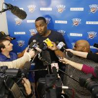 Photo - Oklahoma City Kendrick Perkins talks to the media at the Thunder's practice facility in Oklahoma City, Friday May 23, 2014.Thunder GM Sam Presti released a statement saying the swelling in Serge Ibaka's calf has reduced and they will be upgrading his status to day-to-day. Photo By Steve Gooch, The Oklahoman