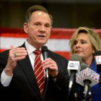 Photo -   Chief Justice candidate Roy Moore speaks to the media after arriving at his headquarters Tuesday, Nov. 6, 2012, in Montgomery, Ala. He faces Democratic challenger Robert Vance. (AP Photo/The Montgomery Advertiser, Julie Bennett) NO SALES
