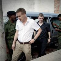 Photo - FILE- Norwegian citizens Tjostolv Moland, left, and Joshua French, right, arriving for their trial process in Kisangani, Congo, in this file photo dated Thursday Dec. 3, 2009, on charges of killing their driver Abedi Kasongo, espionage, armed robbery and organised crime.  According to government officials and his lawyer Sunday Aug. 18, 2013, Moland has died in prison, aged 32.  The cause of death wasn't immediately clear, attorney Hans Marius Graasvold said, while also declaring that British-Norwegian citizen Joshua French, who was imprisoned alongside Moland, is upset but in good health. (AP Photo, FILE)  NORWAY OUT