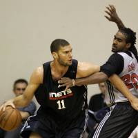 Photo - New Jersey Nets center Brook Lopez (11) works his way around Chicago Bulls guard JamesOn Curry during an NBA summer league basketball game in Orlando, Fla., Thursday, July 10, 2008. (AP Photo/John Raoux) ORG XMIT: FLJR104