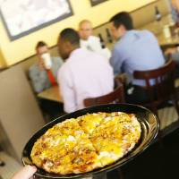 Photo - A BBQ Chicken Pizza is served at the new Cafe 7 inside the First National Center in downtown Oklahoma City.