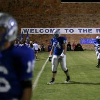 Photo - JELSMA STADIUM / THE ROCK / STADIUM / HIGH SCHOOL FOOTBALL: Guthrie players walk toward the sideline after a team huddle before they played Western Heights in Guthrie on Friday, Oct. 28, 2011. Photo by John Clanton, The Oklahoman ORG XMIT: KOD