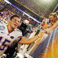 Photo -  Florida quarterback Tim Tebow celebrates with fans after the BCS National Championship college football game between the University of Oklahoma Sooners (OU) and the University of Florida Gators (UF) on Thursday, Jan. 8, 2009, at Dolphin Stadium in Miami Gardens, Fla. The Florida Gators won, 24-14. PHOTO BY NATE BILLINGS, THE OKLAHOMAN