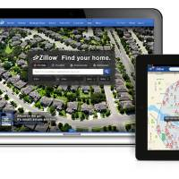 Photo - This product image provided by real estate website operator Zillow shows the Zillow app on various mobile platforms. Zillow is buying competitor Trulia in a $3.5 billion all-stock deal. Trulia's stock rose more than 14 percent in premarket trading on Monday, July 28, 2014, while Zillow's stock fell more than 3 percent. (AP Photo/Zillow)