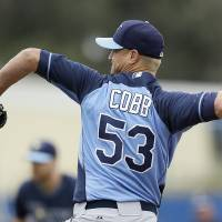 Photo - Tampa Bay Rays starting pitcher Alex Cobb throws a pitch during the first inning of an exhibition baseball game against the Toronto Blue Jays Friday, March 7, 2014, in Dunedin, Fla. (AP Photo/Charlie Neibergall)