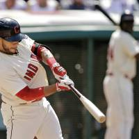 Photo - Cleveland Indians' Mike Aviles hits a three-run home run off Colorado Rockies starting pitcher Franklin Morales in the second inning of a baseball game Saturday, May 31, 2014, in Cleveland. (AP Photo/Mark Duncan)