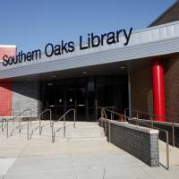 Photo - New sign and entrance at the remodeled Southern Oaks Library.  Photo by Paul B. Southerland, The Oklahoman  PAUL B. SOUTHERLAND - PAUL B. SOUTHERLAND