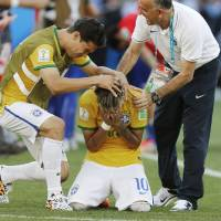 Photo - Brazil's Neymar reacts after the penalty shootout at the World Cup round of 16 soccer match between Brazil and Chile at Mineirao Stadium in Belo Horizonte, Brazil, Saturday, June 28, 2014. Brazil won 3-2 on penalties after Neymar scored the winner in the shootout. (AP Photo/Frank Augstein)