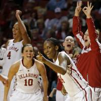 Photo - Oklahoma's Sharane Campbell (24) reacts after a basket during a women's college basketball game between the University of Oklahoma and TCU at the Llyod Noble Center in Norman, Okla., Wednesday, Jan. 30, 2013. Oklahoma won 74-53. Photo by Bryan Terry, The Oklahoman