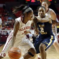 Photo - Oklahoma Sooner's Aaryn Ellenberg (3) drives around West Virginia Mountaineers' Taylor Palmer (2) as the University of Oklahoma Sooners (OU) play the West Virginia Mountaineers in NCAA, women's college basketball at The Lloyd Noble Center on Wednesday, Jan. 2, 2013  in Norman, Okla. Photo by Steve Sisney, The Oklahoman