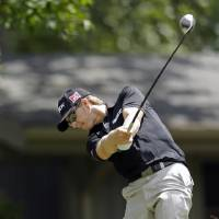 Photo - Chris Stroud hits his tee shot on the ninth hole during the first round of the Wyndham Championship golf tournament at the Sedgefield Country Club in Greensboro, N.C., Thursday, Aug. 15, 2013. (AP Photo/Chuck Burton)