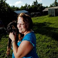 Photo - Heather McDaniel, the co-founder and director of Must Love Dogs Rescue, poses at their Harrah, Okla., headquarters on Tuesday, July 21, 2009. By John Clanton, The Oklahoman ORG XMIT: KOD