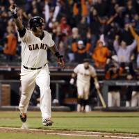 Photo - San Francisco Giants' Hector Sanchez runs down the first base line after driving in the game-winning run during the 12th inning of a baseball game against the Los Angeles Dodgers on Wednesday, April 16, 2014, in San Francisco. San Francisco won 3-2.  (AP Photo/Marcio Jose Sanchez)