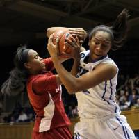Photo - Duke's Oderah Chidom, right, fights for a rebound with Alabama's Daisha Simmons during the first half of an NCAA college basketball game in Durham, N.C., Sunday, Nov. 17, 2013.  Duke led at halftime 47-24.  (AP Photo/Ted Richardson)