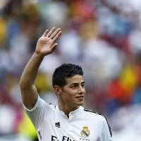 Photo - FILE - In this July 22, 2014 file photo, new Real Madrid player James Rodriguez, from Colombia, waves during his official presentation at the Santiago Bernabeu stadium in Madrid, Spain. Real Madrid have signed Rodriguez from Monaco on a six-year contract,  (AP Photo/Daniel Ochoa de Olza, File)