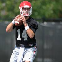 Photo - CORRECTS NAME OF PHOTOGRAPHER IN CAPTION  - Georgia quarterback Hutson Mason drops back to pass during NCAA college football practice Friday, Aug. 1, 2014, in Athens, Ga. (AP Photo/Athens Banner-Herald, AJ Reynolds)